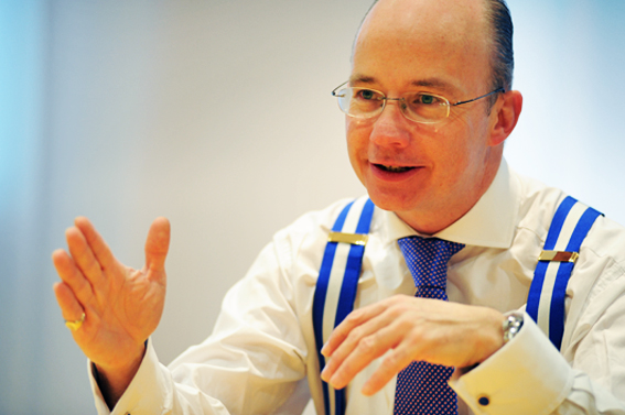Environmental corporate photography of positive businessman communicating with clients in London