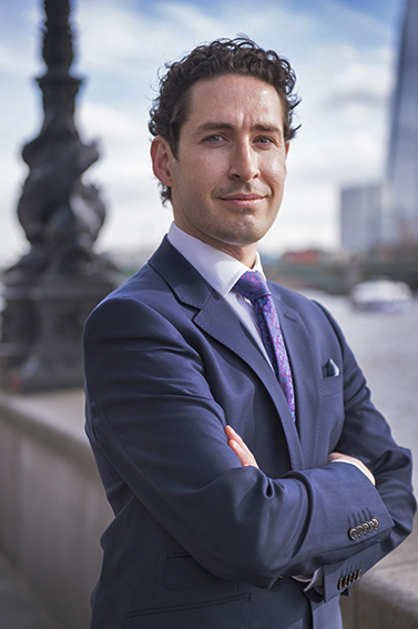 Managing director's portrait taken on the north bank of the Thames with the Shard in background