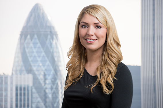 Corporate portrait photography with a photoshopped City background of the Gherkin added