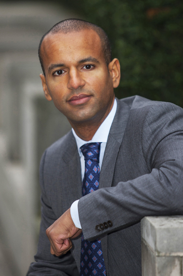 London location headshot for business director for his LinkedIn profile page