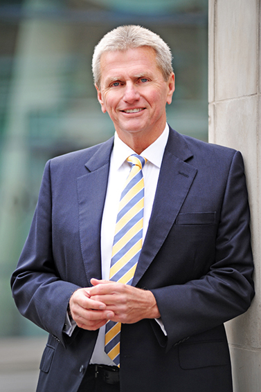 commercial director outside London building for his corporate portrait