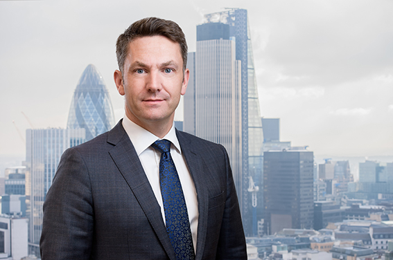 Corporate headshots with City of London background photoshopped on them.