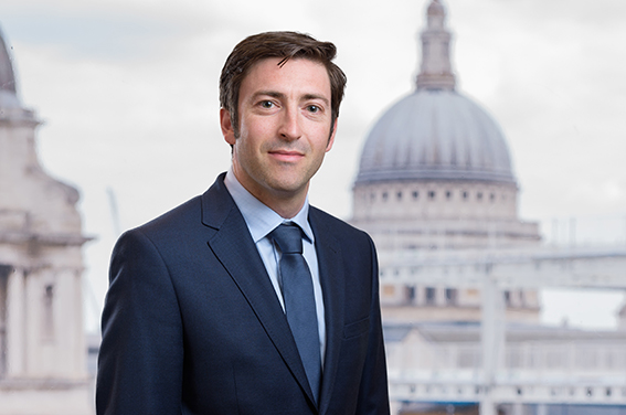 London headshot of businessman with a view of St Paul's photoshopped in the background