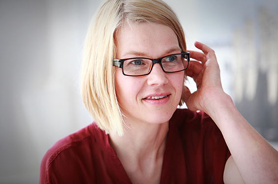 Reportage headshot of businesswoman in meeting