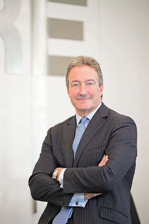 Corporate headshot and portrait of CEO in London offices.