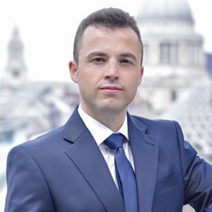 Professional LinkedIn headshot captured with London City background